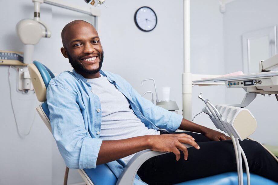smiling man in dental examination chair